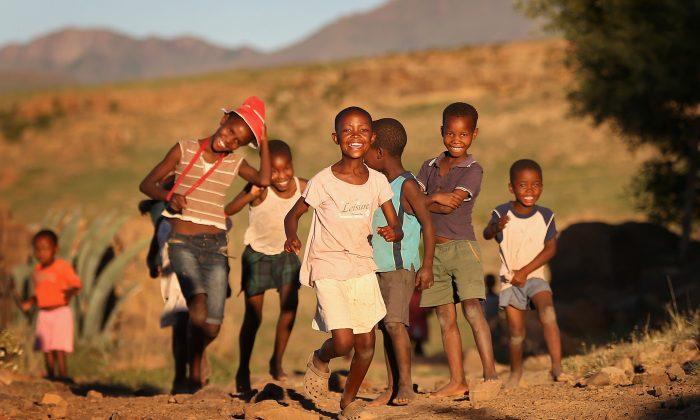 Children run towards charity workers in Morija, Lesotho, on Feb. 23, 2013. (Chris Jackson/Getty Images)