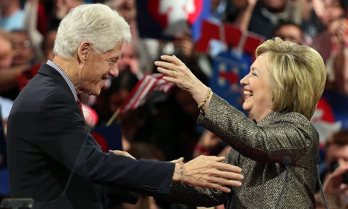 Democratic presidential candidate and former U.S. Secretary of State Hillary Clinton embraces her husband, former President Bill Clinton, at a primary night campaign event April 26, 2016 in Philadelphia, Pennsylvania. (Photo by Win McNamee/Getty Images)