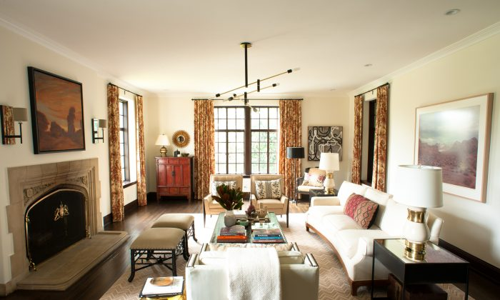 A living room designed by Betsy Burnham of Burnham Design. A couple's contrasting tastes are both represented: Sleek, modern furniture and lighting mix beautifully with soft floral drapes and colourful, patterned pillows. (John Hugstad/Burnham Design via AP)