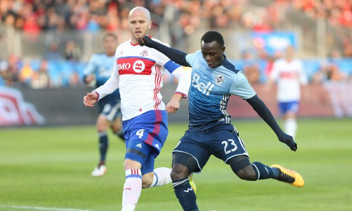Vancouver Whitecaps winger Kekuta Manneh scores against Toronto FC in Toronto on May 14, 2016. The Gambian scored two goals against the second best defense in MLS. (The Canadian Press/Peter Power)
