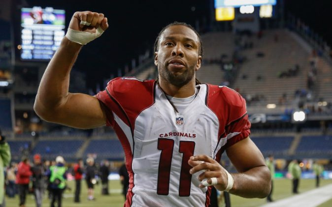 Wide receiver Larry Fitzgerald #11 of the Arizona Cardinals heads off the field after defeating the Seattle Seahawks 39-32 at CenturyLink Field on November 15, 2015 in Seattle, Washington. (Otto Greule Jr/Getty Images)