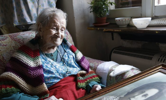 FILE - In this Friday, June 26, 2015 photo, Emma Morano, 116, sits in her apartment in Verbania, Italy. At 116 years of age, Emma is now the oldest person in the world and is believed to be the last surviving person in the world who was born in the 1800s, coming into the world on Nov. 29, 1899. That's just 4 and a half months after Susannah Mushatt Jones, who died Thursday in New York at the age of 116. (AP Photo/Antonio Calanni, File)