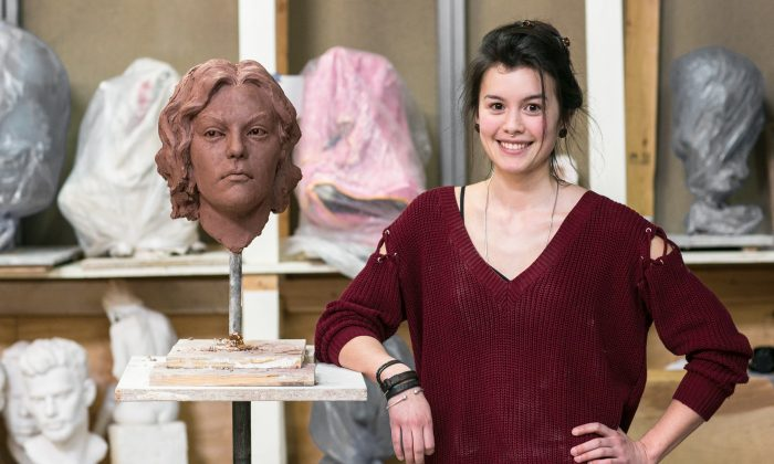 Zoe Dufour with one of her sculptures in progress at the Grand Central Atelier in Queens, New York, on April 14, 2016. (Benajmin Chasteen/Epoch Times)
