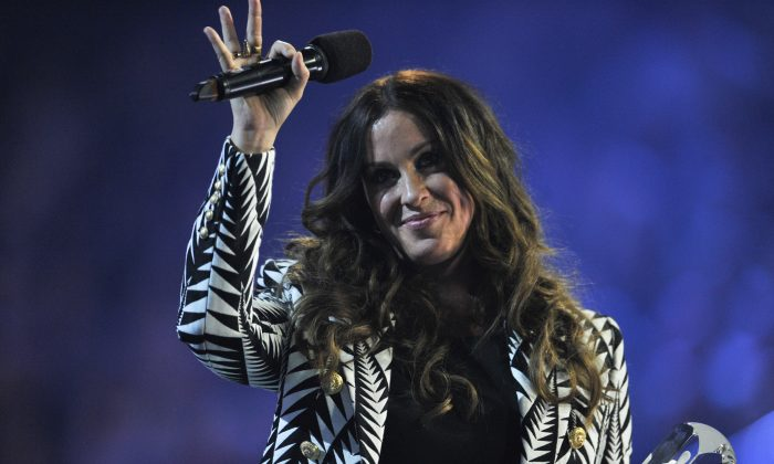 Alanis Morissette is presented an award at the 2015 JUNO Awards at FirstOntario Centre on March 15, 2015 in Hamilton, Canada.  (Photo by Sonia Recchia/Getty Images)