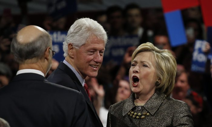 US Democratic presidential candidate Hillary Clinton and husband, former US president Bill Clinton greet supporters during a primary night event on April 26, 2016 in Philadelphia after winning the Pennsilvania state primary. (Photo credit should read EDUARDO MUNOZ ALVAREZ/AFP/Getty Images)