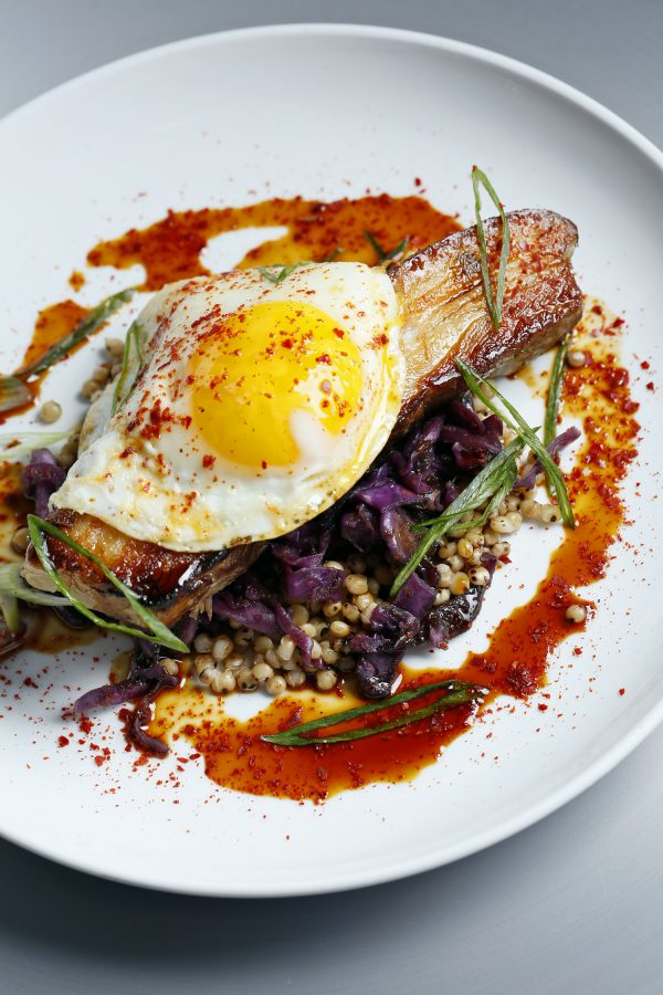 Tinker Street's Pork Belly with kimchee, forbidden rice, sorghum glaze, and farm egg. (Courtesy of Tinker Street)