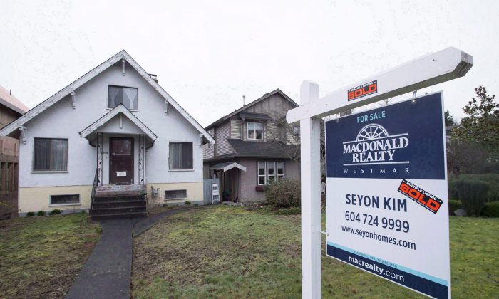 A sold home in Vancouver on Feb. 11, 2016. The presence of foreign money is changing the landscape in Vancouver's and Toronto's housing markets. (The Canadian Press/Jonathan Hayward)