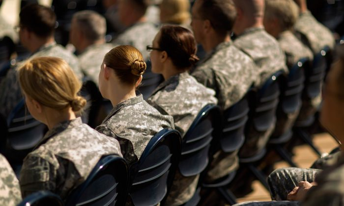 Soldiers, officers and civilian employees attend the commencement ceremony for the U.S. Army's annual observance of Sexual Assault Awareness and Prevention Month in the Pentagon Center Courtyard March 31, 2015 in Arlington, Virginia. (Photo by Chip Somodevilla/Getty Images)