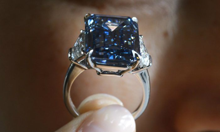 the 'Oppenheimer Blue,' a rare fancy vivid blue diamond weighing 14.62 carat during a press preview by Christies's auction house on May 12, 2016 in Geneva. (Fabrice Coffrini/AFP/Getty Images)