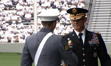 Lt. Gen. Robert Caslen Jr., superintendent of the U.S. Military Academy (R) gives diploma to cadet at commencement ceremonies at West Point on May 21, 2016. (courtesy West Point)