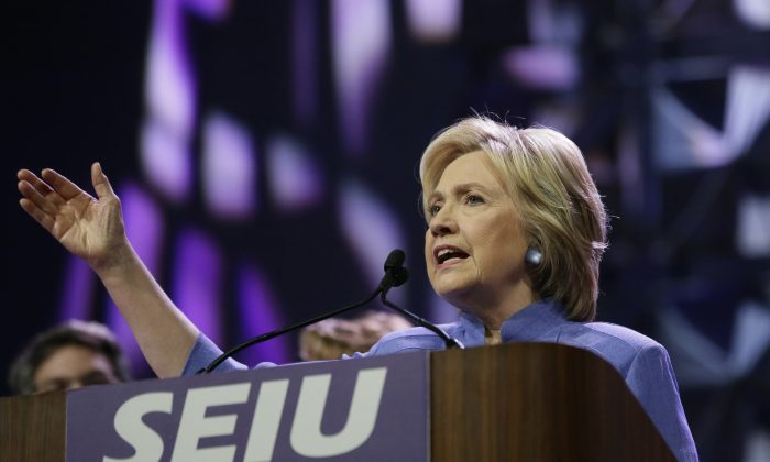 Democratic presidential candidate Hillary Clinton gestures while speaking to more than 3,000 Service Employees International Union (SEIU) members at the union's 2016 International Convention, Monday, May 23, 2016, in Detroit. (AP Photo/Carlos Osorio)