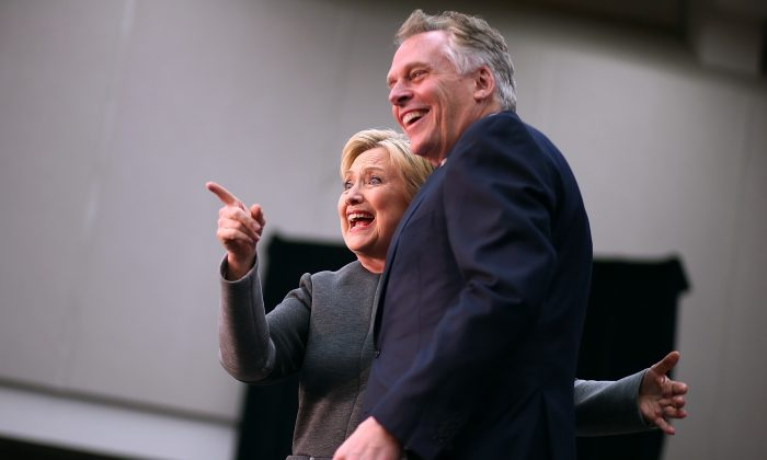 """Democratic presidential candidate former Secretary of State Hillary Clinton greets supporters with Virginia Gov. Terry McAuliffe during a """"Get Out The Vote"""" event at George Mason University  on February 29, 2016 in Fairfax, Virginia. (Photo by Justin Sullivan/Getty Images)"""