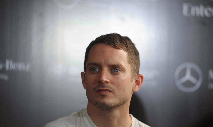 US actor Elijah Wood attends a press conference in Mumbai on September 3, 2015.  Woods, who is also a DJ, is in India on a tour with his group Wooden Wisdom with fellow DJ Zach Cowie. AFP PHOTO        (Photo credit should read STR/AFP/Getty Images)