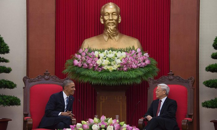 President Barack Obama meets with Communist Party of Vietnam General Secretary Nguyen Phu Trong at the Communist Party of Vietnam's Central Office in Hanoi on May 23. After Obama lifted the U.S. arms embargo on Vietnam, China released an uncharacteristically supported response. (Jim Watson/AFP/Getty Images)