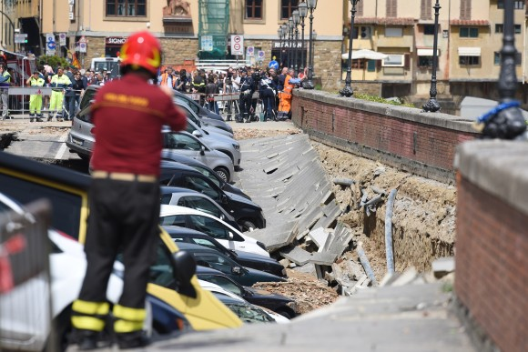A picture shows damaged cars along the Arno river where the embankment collapsed early on May 25, 2016 in central Florence. The damage, stretching between the 14th century Ponte Vecchio and the Ponte alle Grazie, affected about 200 metres of the embankment in total. Emergency services said the collapse was due to a water pipe break and authorities stopped traffic along the road. (CLAUDIO GIOVANNINI/AFP/Getty Images)