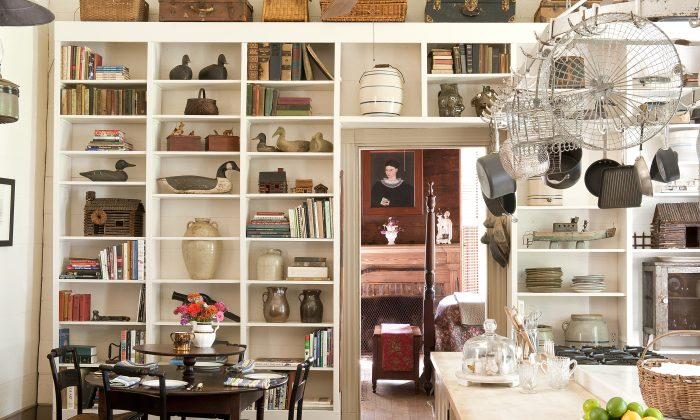 Antiques fill kitchen shelving in an 1850's Alabama farmhouse.  (Susan Sully/The Monacelli Press via AP)