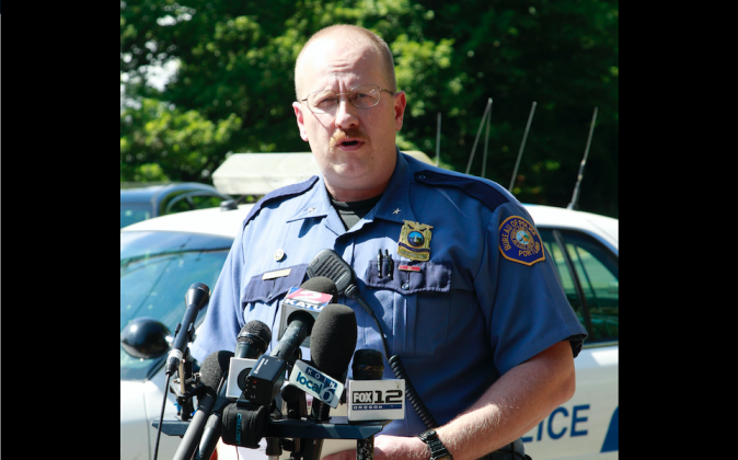 Portland police officer Larry O'Dea speaks during a news conference after remains were found in a search in Portland, Ore. on Friday July 15, 2011. (AP Photo/Rick Bowmer)