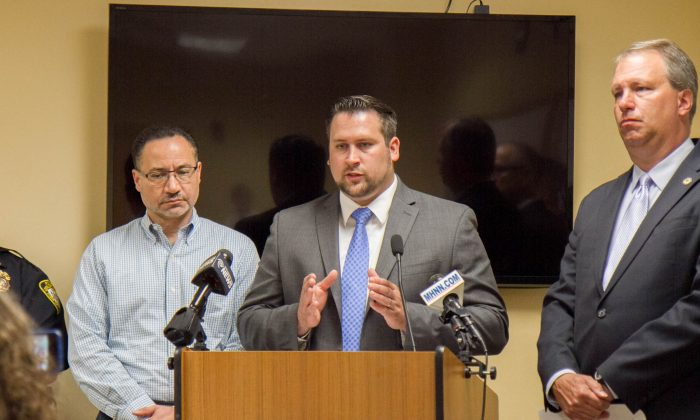 Supervisor Dan Depew announces additional funding for three more police officers for the Town of Wallkill during a press conference at the Wallkill Police Department on May 26, 2016. (Holly Kellum/Epoch Times)