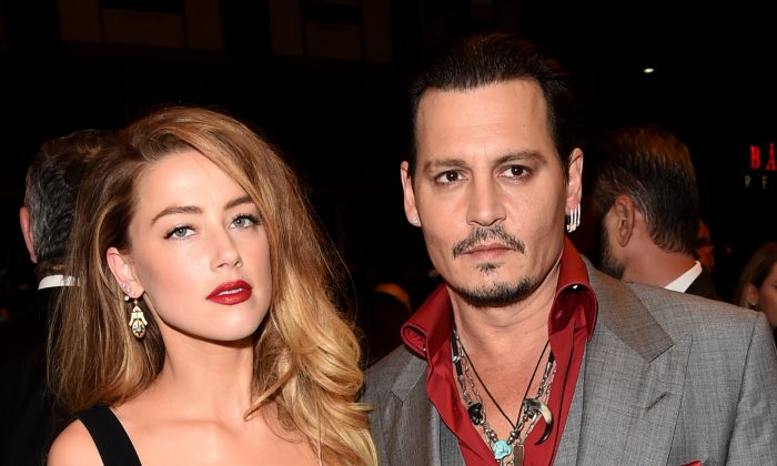 "Actors Amber Heard (L) and Johnny Depp attend the ""Black Mass"" premiere during the 2015 Toronto International Film Festival at The Elgin on Sept. 14, 2015 in Toronto. (Jason Merritt/Getty Images)"