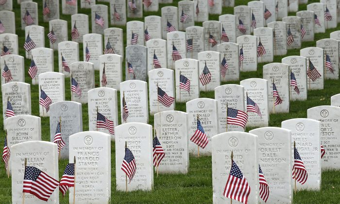 American flags at the graves of U.S. soldiers buried at Arlington National Cemetery, in preparation for Memorial Day in Arlington, Va., on May 21, 2015. (Win McNamee/Getty Images)