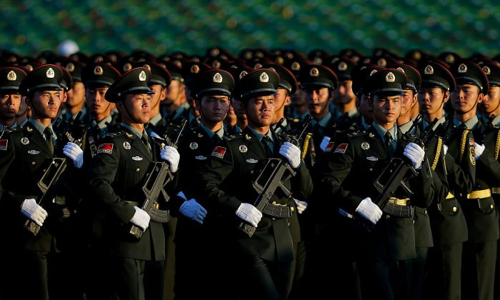 Chinese People's Liberation Army troops practice marching as they arrive at Tiananmen Gate for a military parade on Sept. 3, 2015 in Beijing, China. (Andy Wong/Getty Images)