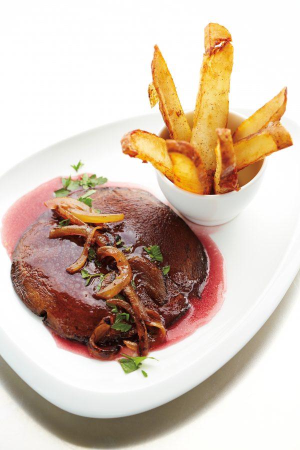 Vedge's vegan take on steak frites: Portobello Frites with red wine reduction, tarragon, and dijon mustard. (Michael Spain-Smith)
