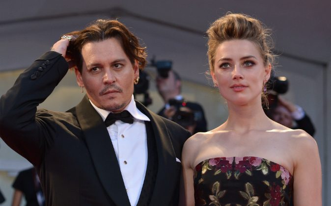 US actress Amber Heard arrives with her husband US actor Johnny Depp for the screening of the movie 'The Danish Girl' presented in competition at the 72nd Venice International Film Festival on September 5, 2015 at Venice Lido. (TIZIANA FABI/AFP/Getty Images)