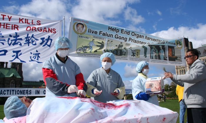 This file photo shows re-enactment of organ harvesting in China on Falun Gong practitioners, during a rally in Ottawa, Canada, 2008. (Epoch Times)