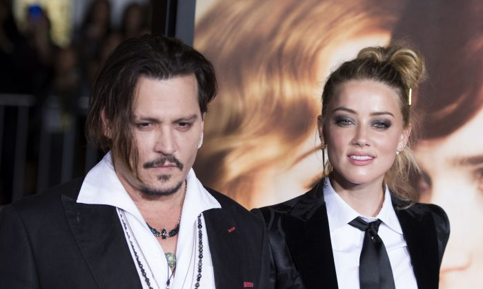 "Actors Johnny Depp (L) and Amber Heard attend the Los Angeles Premiere of ""The Danish Girl"",  in Westwood, California, on November 21, 2015.(VALERIE MACON/AFP/Getty Images)"