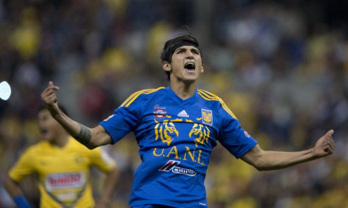 Tigres' forward Alan Pulido celebrates after scoring a goal against America during their Mexican Apertura 2013 tournament quarterfinal football match at the Azteca stadium in Mexico City on December 1, 2013. (Yuri Cortez/AFP/Getty Images)