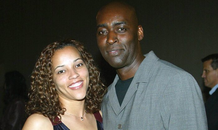 ctor Michael Jace (R) and April Jace attend the third season premiere screening of 'The Shield' at the Zanuck Theater on March 8, 2004 in Los Angeles, California. The series 'The Shield' will premiere on the FX Network on March 9, 2004. (Photo by Frederick M. Brown/Getty Images)
