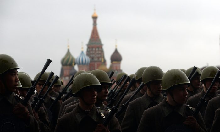 Wearing the WWII-era Red Army uniform Russian soldiers stand at the Red Square in Moscow, on Nov. 5, 2013, during a rehearsal for a military parade. (Vasily Maximov/AFP/Getty Images)