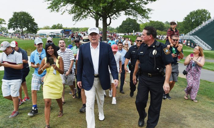 Presidential candidate Donald Trump walks the course during the final round of The Barclays at Plainfield Country Club on August 30, 2015 in Edison, New Jersey.  (Photo by Ross Kinnaird/Getty Images)