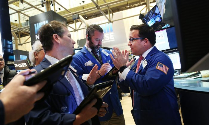 Stock traders on the floor of the New York Stock Exchange face an eventful June. (Spencer Platt/Getty Images)