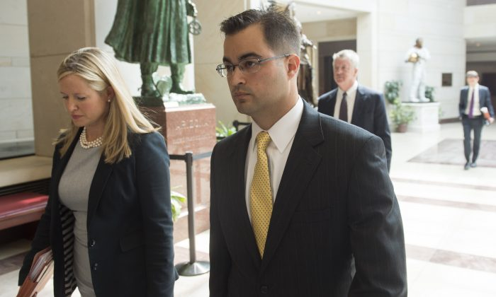 Bryan Pagliano (R), a former State Department employee who worked on former US Secretary of State and Democratic Presidential hopeful Hillary Clinton's private e-mail server. (Photo credit should read SAUL LOEB/AFP/Getty Images)