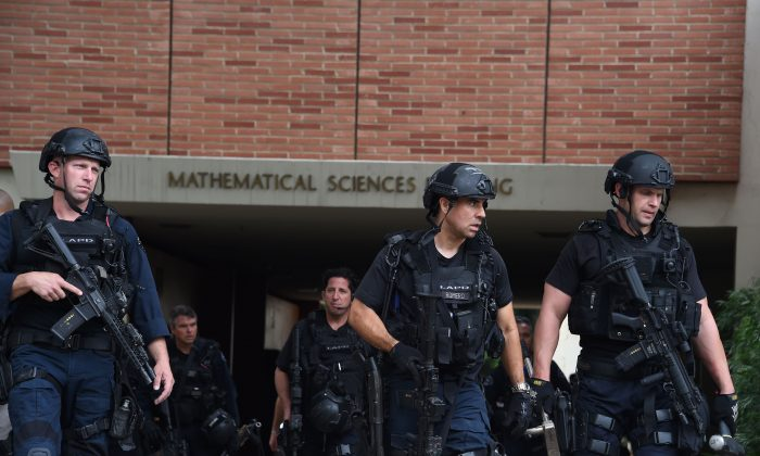 Los Angeles Police Department officers patrol the University of California Los Angeles (UCLA) campus after a shooting, June 1, 2016, in Los Angeles, California. (Robyn Beck/AFP/Getty Images)