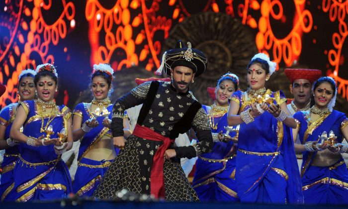 Indian Bollywood actor Ranveer Singh performs at the annual 'Mumbai Police Melawa' show in Mumbai on January 19, 2016. (STR/AFP/Getty Images)