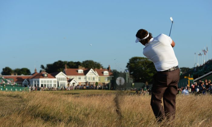 Phil Mickelson  hits a shot on the 18th during the second round of the 142nd Open Championship at Muirfield on July 19, 2013 in Gullane, Scotland. (Stuart Franklin/Getty Images)