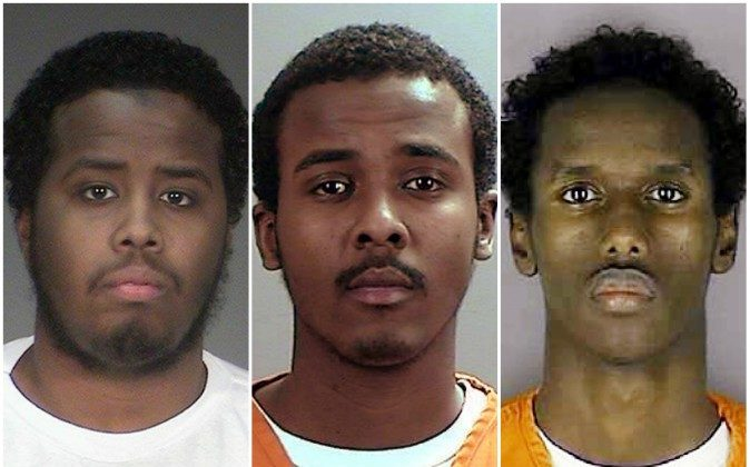 22-year-old Mohamed Farah, left, 22-year-old Abdirahman Daud, middle, and 21-year-old Guled Omar have all been found guilty for conspiring to support ISIL. (Hennepin County Sheriff's Office/AP)