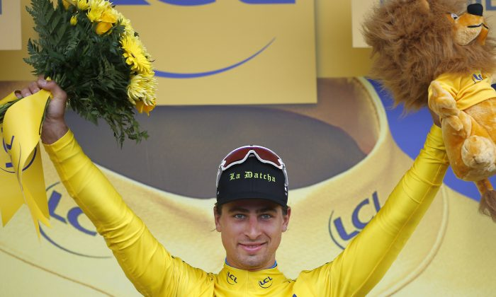Peter Sagan celebrates on the podium after winning Stage 2 of the Tour de France, 183 kilometers (113.7 miles) from Saint-Lo to Cherbourg-en-Cotentin, France, Sunday, July 3, 2016. (AP Photo/Peter Dejong)