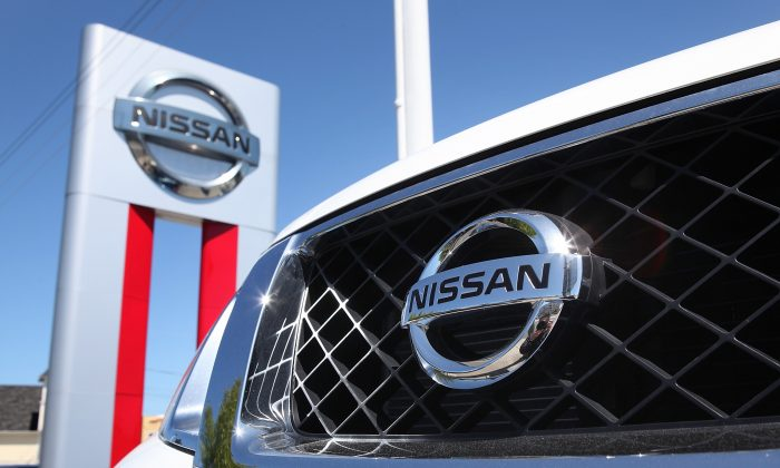 The Nissan logo is seen on the front of a brand new Nissan SUV at a Nissan dealership in Millbrae, Calif., on May 12, 2011. (Justin Sullivan/Getty Images)