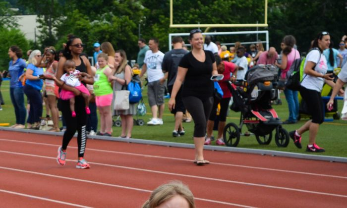 Young runner at the Junior Division of 10K Classic at Middletown High School Stadium in Middletown on June 3, 2016. (Yvonne Marcotte/Epoch Times)
