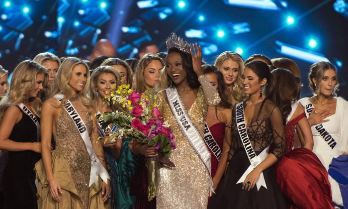 Miss District of Columbia Deshauna Barber smiles after being crowned Miss USA during the 2016 Miss USA pageant in Las Vegas, Sunday, June 5, 2016. (Jason Ogulnik/Las Vegas Review-Journal via AP) LOCAL TELEVISION OUT; LOCAL INTERNET OUT; LAS VEGAS SUN OUT