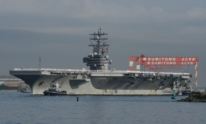 (FILE) Aircraft carrier USS Ronald Reagan arrives at the US Navy base in Yokosuka, a suburb of Tokyo, on October 1, 2015.(Toru Yamanaka/AFP/Getty Images)