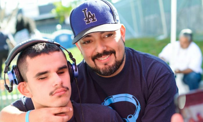Paul Avila (R) and his son, Pauly Avila (L), who is blind and autistic. (Courtesy of Pauly's Project)