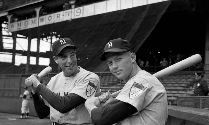 Joe DiMaggio (L) Yankees' star centerfielder, and rookie Mickey Mantle shoulder bats at Ebbets Field in Brooklyn, April 14, 1951, as the New York Yankees met the Brooklyn Dodgers in a short exhibition series that marked Mantle's New York debut. (AP Photo)