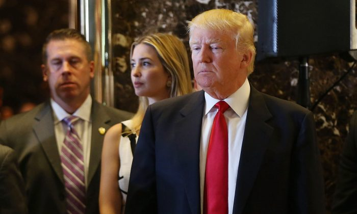 Republican presidential candidate Donald Trump enters a news conference next to his daughter, Ivanka, at Trump Tower in New York City on May 31, 2016, where he addressed issues about the money he pledged to donate to veterans' groups following a skipped debate in January before the Iowa caucuses. (Spencer Platt/Getty Images)