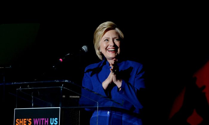 """Democratic presidential candidate Hillary Clinton speaks onstage during the """"Hillary Clinton: She's With Us"""" concert at The Greek Theatre in Los Angeles, Calif., on June 6, 2016. (Kevin Winter/Getty Images)"""