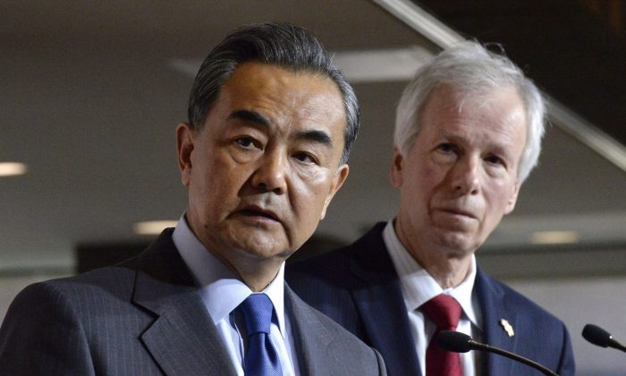 China's Minister of Foreign Affairs Wang Yi and Foreign Affairs Minister Stephane Dion participate in a press conference on June 1, 2016, in Ottawa. (The Canadian Press/Justin Tang)