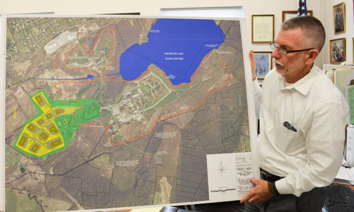 Warwick Town Supervisor Michael Sweeton with a map of the Warwick Office and Technology Corporate Park in Warwick on June 6, 2016. (Yvonne Marcotte/Epoch Times)